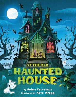 "Three trick-or-treaters stand at the door of a house with witches, vampires, and monsters in its windows. A witch chases a ghost through the graveyard in front of the house. Text: ""At the Old Haunted House By Helen Ketteman Illustrated by Nate Wragg."""