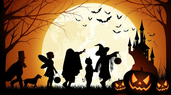 Five trick-or-treaters and their dog are silhouetted against a huge full moon with a castle and bats in the background and three jack-o-lanterns in the foreground.