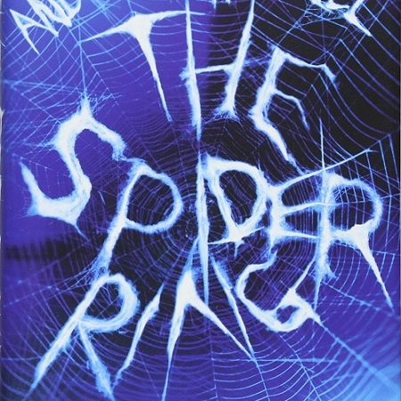 "A white spider's web sits in front of a blue and black background, with a black spider on the bottom right. The web spells out the text: ""Andrew Harwell. The Spider Ring."""