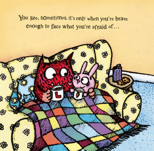 A red fuzzy monster and a pink bunny cuddle under a multicolored quilt on a yellow floral couch as they hold coffee mugs and smile.