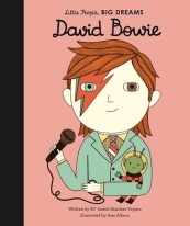 Image: A drawing of a young David Bowie, a boy with pale skin, one blue eye and one brown eye, orange hair, and a red and blue lightning bolt drawn over his blue eye. He wears a suit and tie and holds a microphone in one hand and a toy alien in the other. Text: Little People, BIG DREAMS. David Bowie. Written by Maria Isabel Sánchez Vegara. Illustrated by Ana Albero.